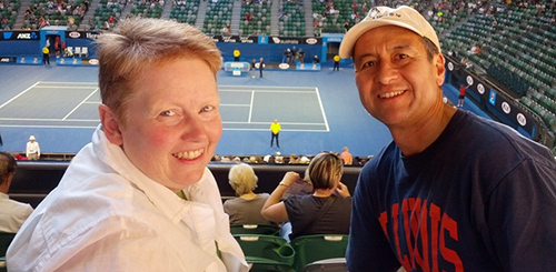 Becky and Victor Andrade '78 ENG at Rod Laver Arena in Melbourne, Australia. The couple hopes to see all of pro tennis' Grand Slam events in person in the coming years. As of 2013, they can check the Australian Open off their bucket list.