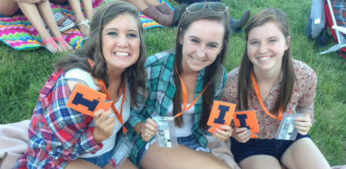 UIUC surprised these Illini fans with tickets to the Illini Fan Deck at First Midwest Bank Amphitheater. Look for opportunities to win on facebook.com/illinois.edu.