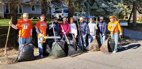 Twin Cities Illini Club members volunteer as part of 2014 iHelp doing fall clean-up for Wingspan Life Resources, which provides housing to developmentally disabled adults.
