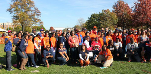 The Illinois Black Alumni Network poses for a photo op during their Homecoming Tailgate on October 24.