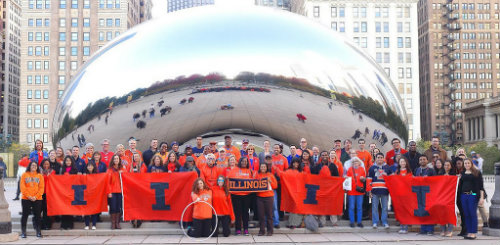 "Illinois alumni put on their orange and gathered at ""The Bean"" in Chicago for #ILLINOIShomecoming Week 2014. Click for more photos!"